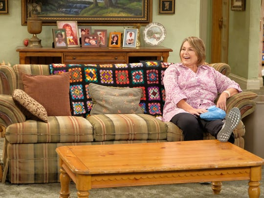 Roseanne (Roseanne Barr) sits alone on the Conner family