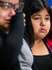 Karla Fomperosa (right), 14, listens to Yennifer Sanchez,