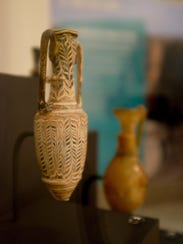 Artifacts from Syria and Iraq are displayed alongside