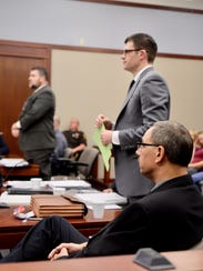 Detective Charles Buckland, right, Assistant Prosecutor