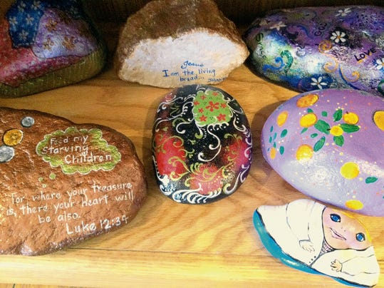 Jeanne Kitsinger creates whimsical and inspirational handpainted rocks, a best seller at Coyote Howling.