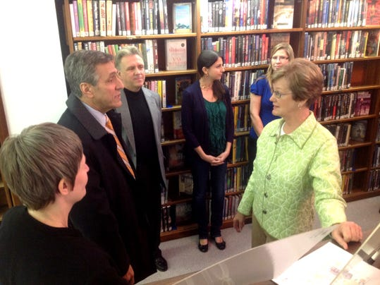 State Rep. Louis Barletta, second from left, listens to Shippensburg Public Library officials during a visit in November 2013.