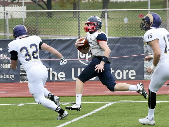 West Chester's Brandon Pepper, left, and Kyle Keyser, right, chase Ryan Zapoticky, of Shippensburg, as he rushes for a touchdown on Saturday. Zapoticky had 94 passing yards and a rushing touchdown in Shippensburg 27-11 win over West Chester.