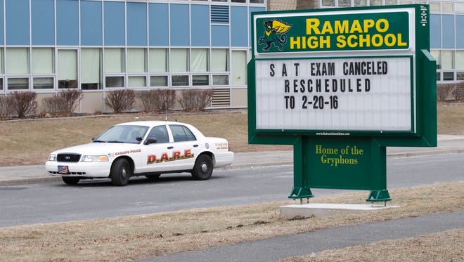 A Ramapo Police car is parked in front of Ramapo High School in Spring Valley after an incident involving two students closed the school on Friday, Feb. 19, 2016.