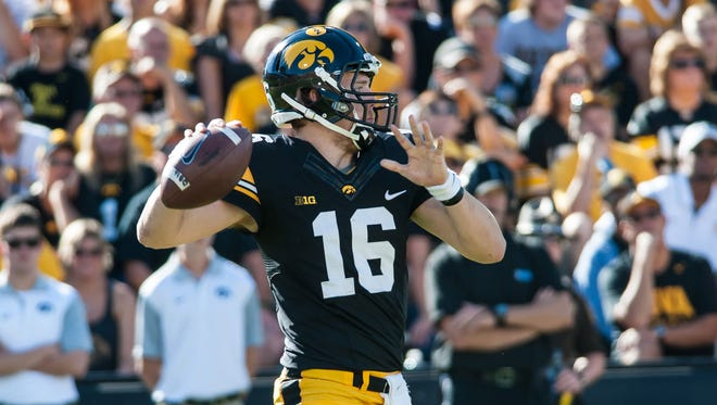 owa Hawkeyes quarterback C.J. Beathard (16) prepares to throw a pass during the second quarter against the North Texas Mean Green at Kinnick Stadium.