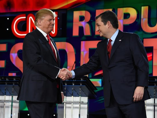 Donald Trump and Ted Cruz shake hands as they are introduced