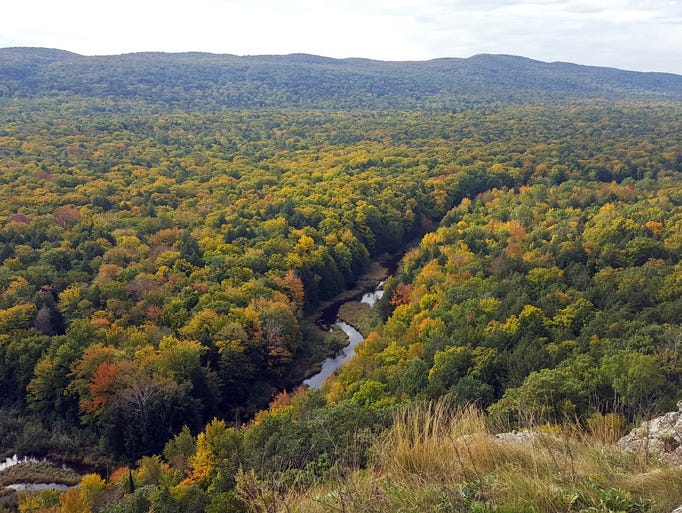 Fall colors surround the Big Carp River in Porcupine
