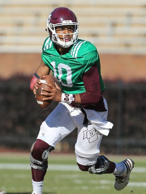 MSU quarterback Keytaon Thompson looks to make a pass in the spring game.