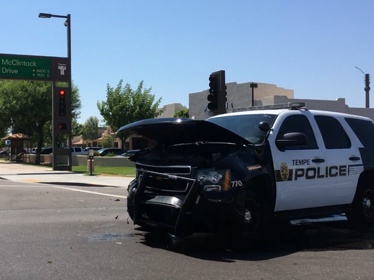 A Tempe police officer responding to a call with lights and siren activated collided with another vehicle at Guadalupe Road and McClintock Drive on July 2, 2017.