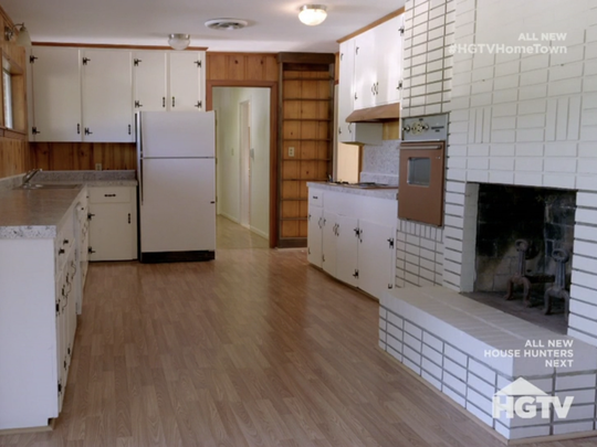 The kitchen and fireplace in the Slade House on HGTV's
