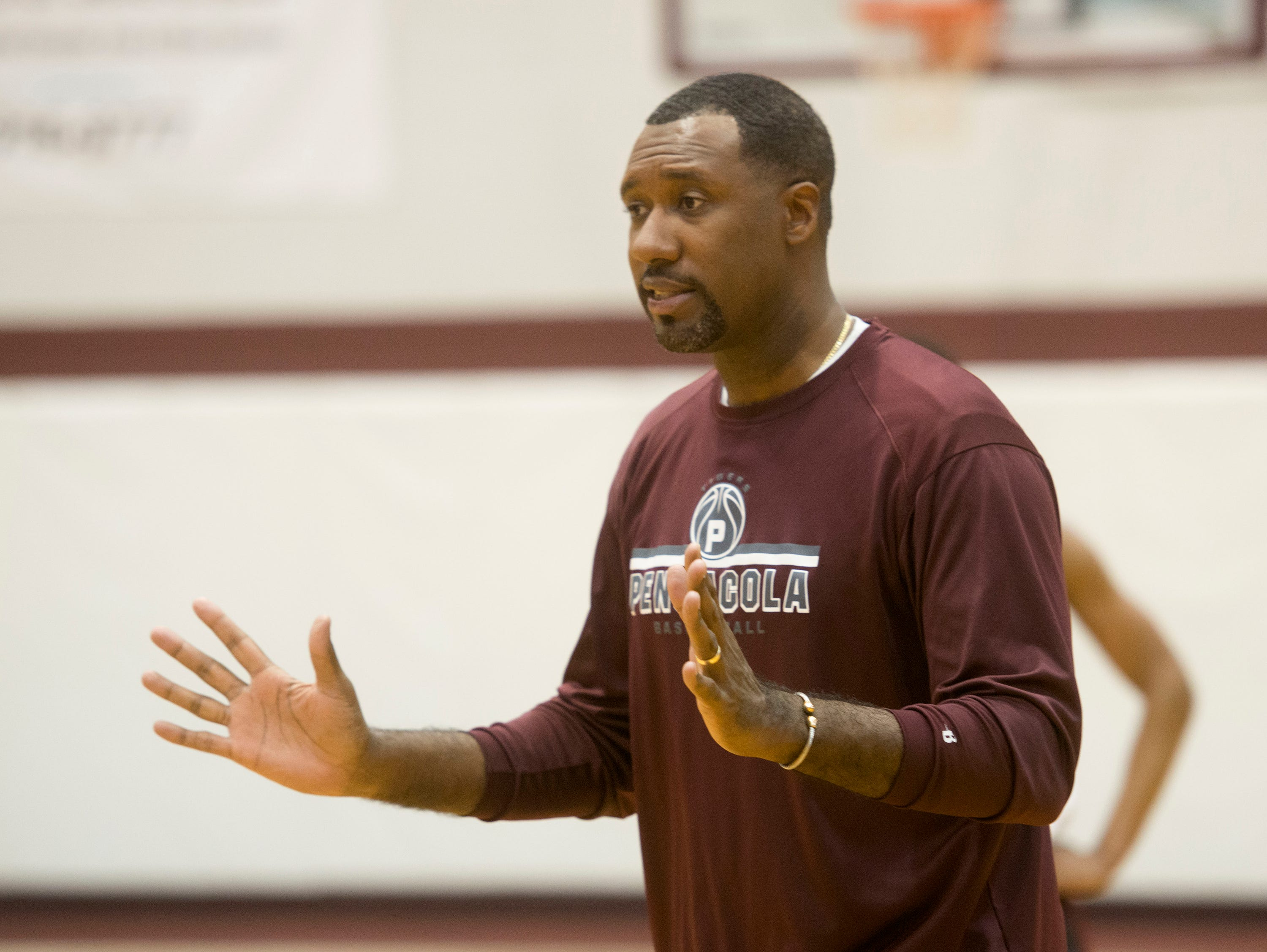 Pensacola High School Basketball coach, Terrence Harris, works to get his team ready for the State 6A Semifinals game in Lakeland.