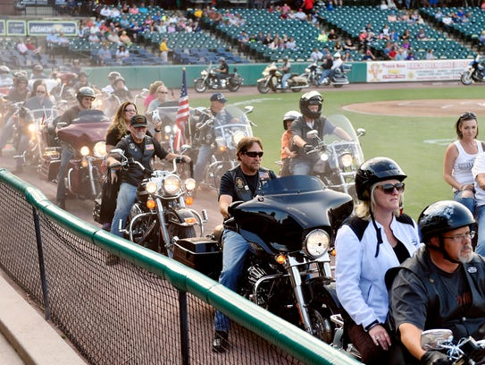 Bikers rev their engines for 21 seconds during a parade