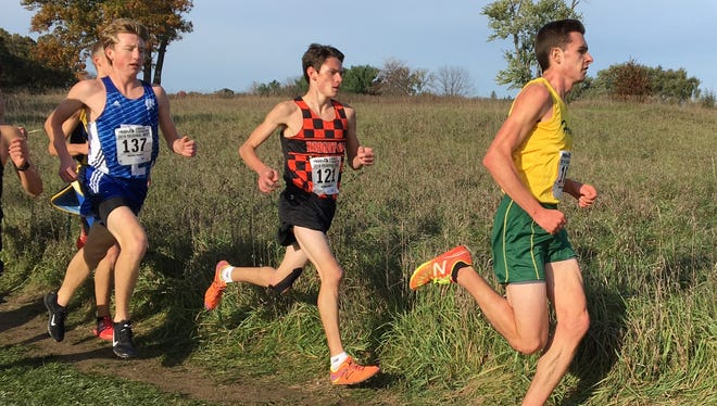Howell's David Mitter (right) finished third and Brighton's Zach Stewart (center) hope to carryover their All-State cross country performances onto the track.