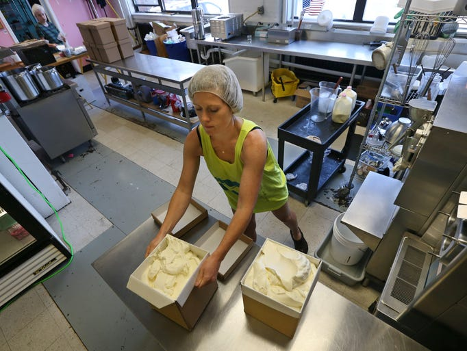 Amber Odhner works on a batch of vanilla ice cream
