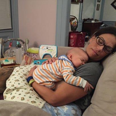 Reporter Victoria Freile falls asleep with her newborn