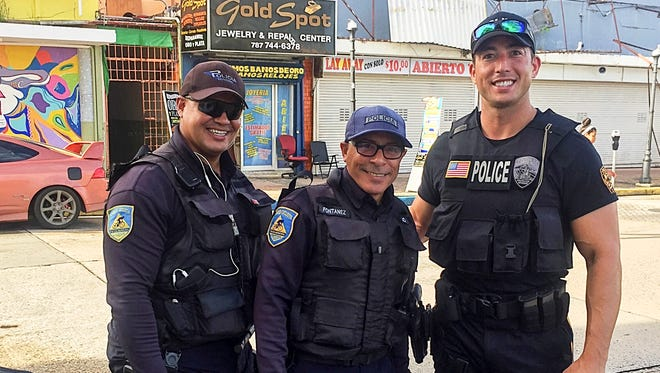 Fanwood Police Officer Elliott Bernard (center), with two officers from the Caguas police, served for two weeks as part of the New Jersey State Police's Law Enforcement Team sent to Puerto Rico after Hurricane Maria.