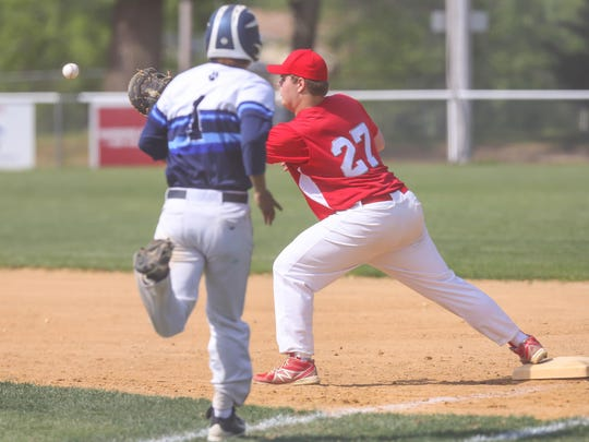 St. Joseph's Ryan Sigloch gets an out at first base during a 7-5 victory over Ranney on May 26.