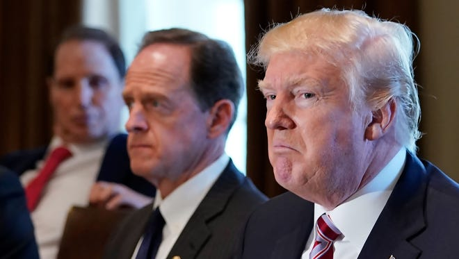 President Trump speaks during a meeting with members of Congress on trade in the Cabinet Room of the White House Tuesday. Sen. Pat Toomey, R-Pa., sits to his right.