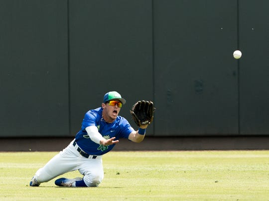 Florida Gulf Coast's Gage Morey dives to make a catch during an NCAA baseball tournament regional game against North Carolina in Chapel Hill, N.C. on Sunday, Jun. 4, 2017.