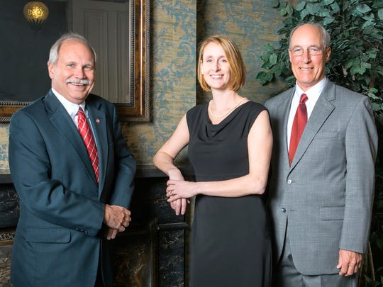 Pictured, from left, are: John A. Klinedinst, Kerryn E. Fulton and David M. Davidson Jr.