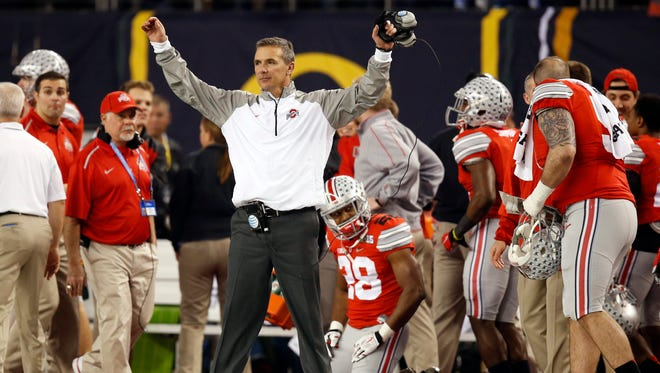 Jan 12, 2015; Arlington, TX, USA; Ohio State Buckeyes head coach Urban Meyer celebrates during the fourth quarter against the Oregon Ducks in the 2015 CFP National Championship Game at AT&T Stadium.