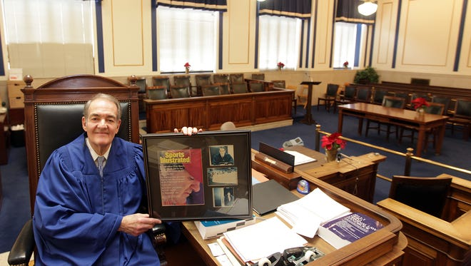 Hamilton County Common Please Judge Norbert Nadel in his courtroom for one of the last times. He's holding a framed magazine cover that included his decision on the Pete Rose case.