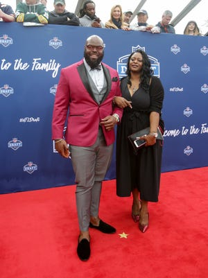 A'Shawn Robinson, picked by the Lions, arrives with his mother Abigail at the NFL draft.