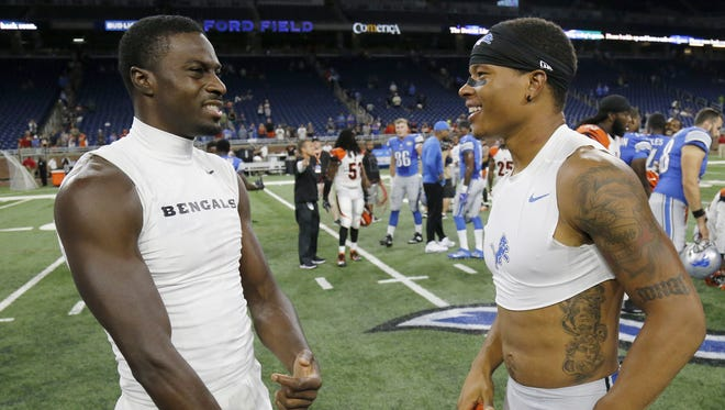 Cincinnati Bengals wide receiver A.J. Green (18) and former Bengals wide receiver Marvin Jones (11) talk on the field after the NFL preseason game between the Detroit Lions and the Cincinnati Bengals at Ford Field in downtown Detroit on Thursday, Aug. 18, 2016. The Bengals improved to 1-1 in the preseason with 30-14 win in Detroit.