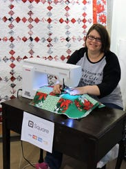 Jessica Carter, owner of Cross and Crown Longarm Quilting