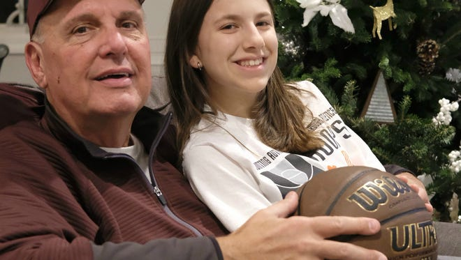 Dwight Morrow girls basketball coach Lou Wejnert and his granddaughter Leah.