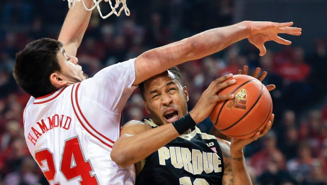 Purdue's Vince Edwards (12) is fouled by Nebraska's Jake Hammond (24) during the first half Tuesday.