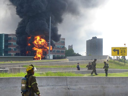 Detroit fireman respond to an explosion and tanker