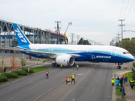 A Boeing 787, the third ever built, is moved across