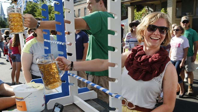 At the 2014 German Fest, Christine Mintert laughs as she tries her hand at the bier stein-holding contest.