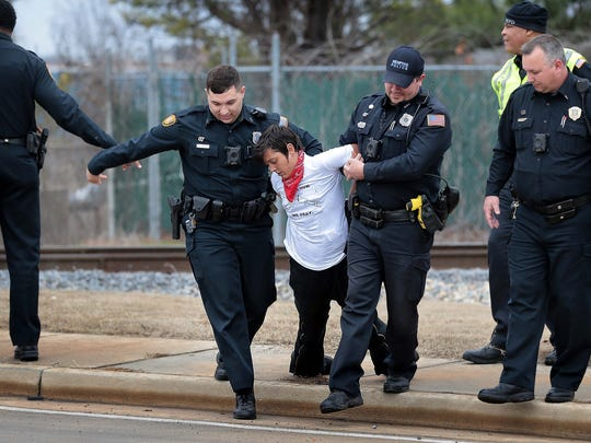 "Memphis police arrested 12 protesters after a demonstration outside the Valero refinery in South Memphis in January. Protesters also gathered at Valero in March to demonstrate against construction of an oil pipeline from Oklahoma to Memphis. ""You can't drink oil,"" they shouted."