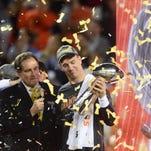 Broncos quarterback Peyton Manning celebrates after winning Super Bowl 50 Sunday night. At left is CBS broadcaster Jim Nantz.