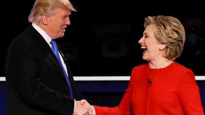 Republican presidential nominee Donald Trump shakes hands with Democratic presidential nominee Hillary Clinton after the presidential debate at Hofstra University in Hempstead, N.Y., Monday, Sept. 26, 2016.
