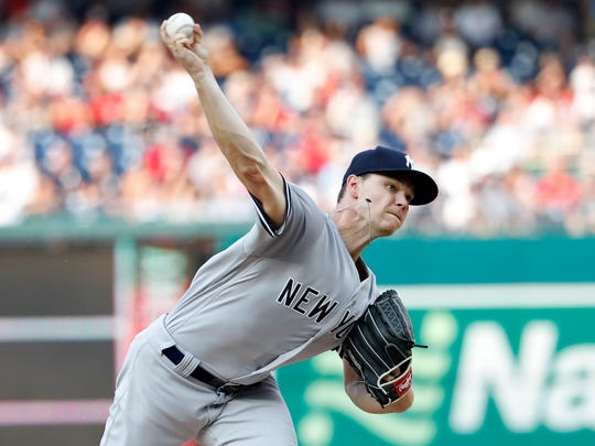 New York Yankees starting pitcher Sonny Gray (55) pitches