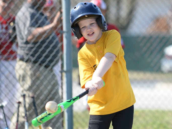 Logan Bowen takes a swing during the opening day of