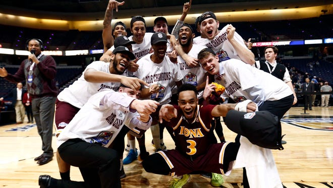 Iona guard Ibn Muhammad (3) and the rest of the team celebrate after defeating the Monmouth Hawks in the MAAC conference tournament finals at Times Union Center.