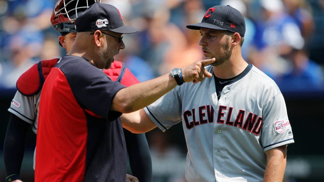 Cleveland Indians manager Terry Francona, left, has words with pitcherTrevor Bauer, right, as Bauer is taken out in the fifth inning of a baseball game against the Kansas City Royals at Kauffman Stadium in Kansas City, Mo., Sunday, July 28, 2019. Bauer threw two baseballs into the stands as he reacted to Royals batter Nicky Lopez's two-RBI single. (AP Photo/Colin E. Braley)