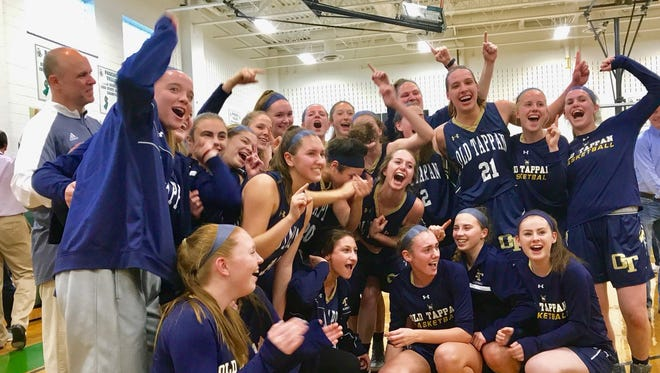 The NV/Old Tappan girls basketball team poses for pictures after beating Pascack Valley in the North 1, Group 3 final.