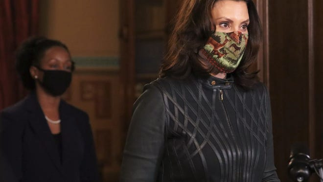 Michigan Gov. Gretchen Whitmer speaks during a briefing on Tuesday, Dec. 1, 2020 from her office in Lansing, Mich. Whitmer said it was too early to determine if a possible extension of the current epidemic order which closes many indoor gatherings would take place.