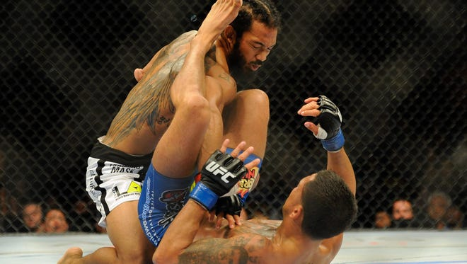Benson Henderson (left) lost to Anthony Pettis during UFC 164 in Milwaukee last August.