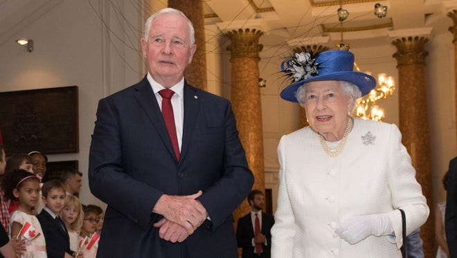 Britain's Queen Elizabeth II is welcomed by Canadian Governor General David Johnston on her arrival at Canada House in London on July 19, 2017, to mark the 150th anniversary of the nation.