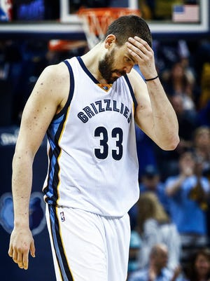 Memphis Grizzlies center Marc Gasol wipes his head during fourth quarter action against the San Antonio Spurs in the sixth game of their NBA first round playoff series at the FedExForum.