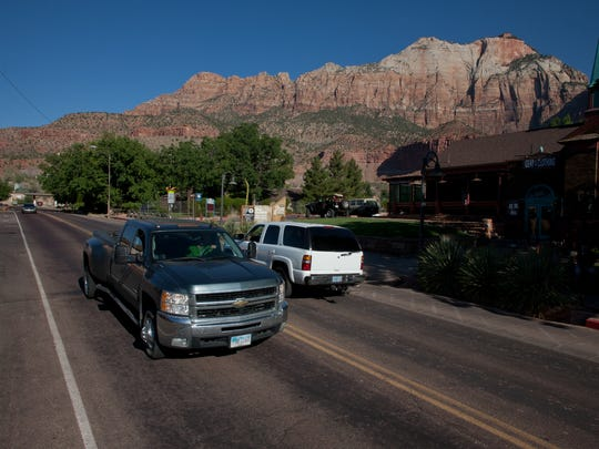 Drivers navigate along state Route 9 near the entrance to Zion National Park in Springdale, Utah on Friday, July 6, 2012.