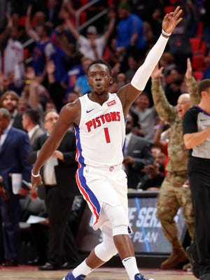 Pistons guard Reggie Jackson (1) celebrates after making a 3-point basket during the fourth quarter of the 111-104 win over the Hawks on Friday, Nov. 10, 2017, at Little Caesars Arena.