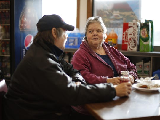Corinth, Maine, resident Nancy Harper has lunch with Walter Keyse. Harper voted for Trump hoping he'll create jobs and get people off welfare even though she worries about his stance on women's rights, hated how he calls people names and thinks Hillary Clinton has more integrity than he does. But she felt Clinton was just too corrupt.