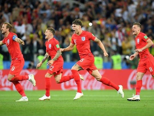 England players (l-r Harry Kane, Kieran Trippier, John